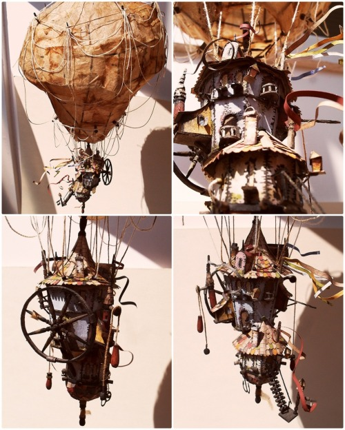 "bookspaperscissors:  Air Balloon My newest idea was to build a machinery which is half building and half ""something that can fly"". The first idea was a zeppelin then I kept drawing until I ended up with this. Scale: 1:200. The building is made of paper, the structure of the balloon is made of toothpicks and then I covered it with paper from tea bags. The ropes are also from tea bags, their strings to be exact. It's about 35 cm high. I built it in exactly 2 weeks. raskolnikov0610"