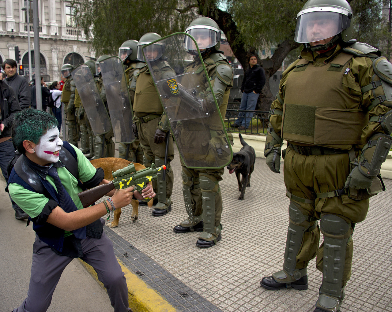 Why so serious, riot police?A student plays with a toy gun in front of a line of riot police officers during protests in Santiago, Chile, on August 25, 2011, during a 48-hour national strike. (Martin Bernetti/AFP/Getty Images)