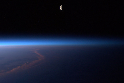 jtotheizzoe:  Moon over Afghanistan, by astronaut Ron Garan (@astro_ron) aboard the ISS. (via Bad Astronomy)