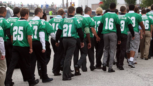 A New Jersey high school football team says goodbye to four teammates who were killed in a tragic car accident.  Wearing their green Mustang jerseys, the Mainland Regional football players gathered as a group at St. Augustine Church to view the body of 17-year-old Edgar Bozzi, killed with three others Saturday in a horrific car accident on the Garden State Parkway. Parents led the way as the players formed two lines and clutched each other's hands, as did a group of female students behind them. Most of those in attendance wore green ribbons with black trim. They would say goodbye to another deceased Mainland player, 15-year-old Dean Khoury, just hours later at a church in nearby Northfield. Two more funerals are scheduled for today and tomorrow.