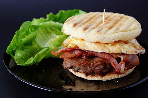 The English breakfast burger: fried egg, bacon, and burger patty on toasted English muffin. Lettuce optional.