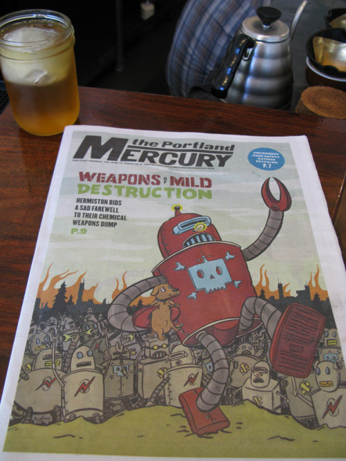 BT Livermore illustrated this week's cover of the Portland Mercury. Here it is in its natural environment, a Portland coffeeshop.