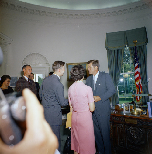 President John F. Kennedy greets the first group of departing Peace Corps Volunteers, leaving for Tanganyika and Ghana, in the the Oval Office. Photographer: Robert Knudsen/White House, John F. Kennedy Presidential Library and Museum, Boston