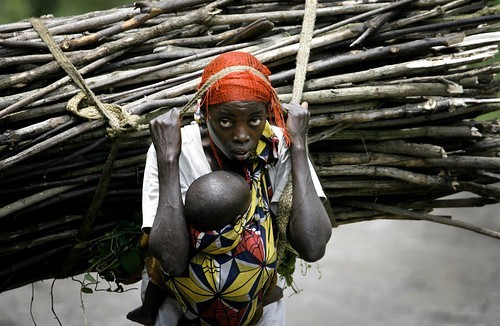 fyeahafrica:  A woman in Congo bearing the burden of both motherhood and hard labour.