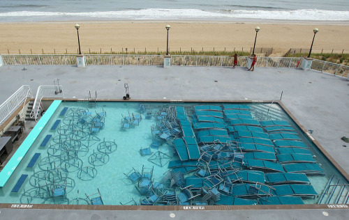 bolus:  Outdoor furniture sits in a pool at the Hilton hotel in Ocean City, Md., on Friday to keep it from blowing away in preparation for Hurricane Irene. Ocean City Mayor Rick Meehan has ordered a mandatory evacuation for thousands of residents and visitors to leave the oceanfront community. PHOTO: MARK WILSON/GETTY IMAGES