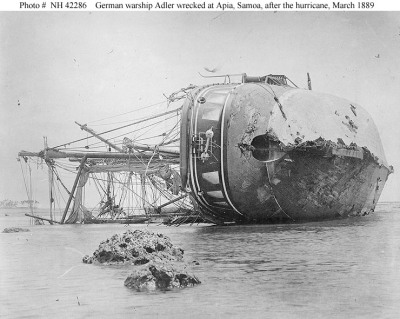 German Gunboat SMS AdlerOverturned on the reef, on the western side of Apia Harbor, Upolu, Samoa, soon after the March 1889 Apia cyclone. Note her battered hull, well for hoisting propeller, rescue bouy mounted on her stern, and decorative windows painted on her quarters. Adler before the Hurricane More Damage Views