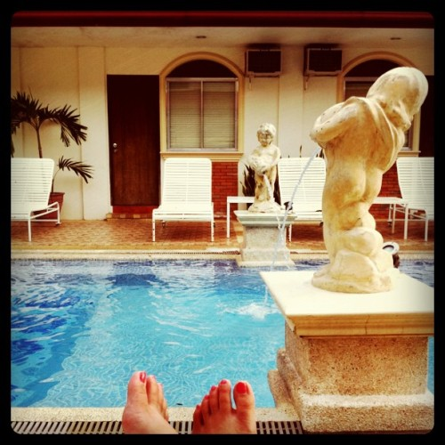 At the #poolside. I needed this. #pool #water #staycation #relax #feet #statue #resort (Taken with instagram)