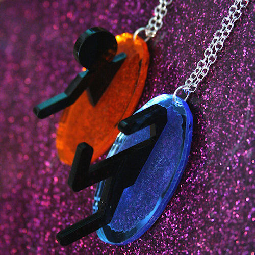 insanelygaming:  Portal Friendship Necklaces - by SVJewellery Available on Etsy  I need my best friend to play portal so I can get her one of these :D
