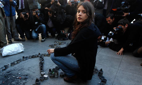 "notangryenough:  Chilean student leader Camila Vallejo sits among a peace sign created from empty teargas canisters used by police against protesters. Photograph: Roberto Candia/AP Not since the days of Zapatistas' Subcomandante Marcos has Latin America been so charmed by a rebel leader. This time, there is no ski mask, no pipe and no gun, just a silver nose ring. Meet Commander Camila, a student leader in Chile who has become the face of a populist uprising that some analysts are calling the Chilean winter. Her press conferences can lead to the sacking of a minister. The street marches she leads shut down sections of the Chilean capital. She has the government on the run, and now even has police protection after receiving death threats. Wednesday saw the start of a two-day nationwide shutdown, as transport workers and other public-sector employees joined the burgeoning student movement in protest. ""There are huge levels of discontent,"" said Vallejo in a recent interview. ""It is always the youth that make the first move … we don't have family commitments, this allows us to be freer. We took the first step, but we are no longer alone, the older generations are now joining this fight."" ""We do not want to improve the actual system; we want a profound change – to stop seeing education as a consumer good, to see education as a right where the state provides a guarantee. ""Why do we need education? To make profits. To make a business? Or to develop the country and have social integration and development? Those are the issues in dispute."" Excerpts from the article on The Guardian Website."