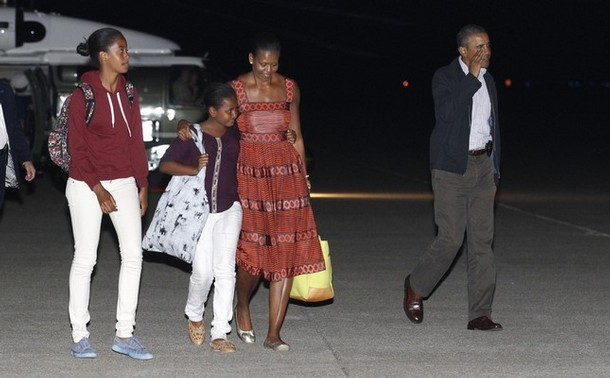 "virtualephemera:  obamafamily:  U.S. President Barack Obama (R) and his family walk to board Air Force One after cutting short by a day their vacation on Martha's Vineyard in Massachusetts August 26, 2011. Obama and his family will cut short their vacation and return to the White House on Friday, before Hurricane Irene hits the U.S. East Coast, the White House said. (via Photo from Reuters Pictures)  When I see pictures of the president and First Lady with their young daughters, it really puts into perspective how ridiculous the debate about presidential vacations is. Sure, he's the leader of the Free World. He's also a father of young children who probably sees them far less often than they'd like. So he had a lighter schedule of public events for a few days so he could see his family a little more than he does the rest of the year. Is that too much to ask? Especially when you consider the amount of work that he still had on his plate this week.  The controversy over the President says a lot more about our thoughts about executive power than it does about any particular President's vacationing habits.  First of all, it's a fake controversy. The left was angry about George W. Bush when he went on vacation. The right is angry when Obama takes a vacation. This is particularly absurd when we consider that neither side seems to like anything the opposing side's Presidents do. When Bush was on vacation, the left could have been all, ""At least he's not there to screw up the country."" Instead, they were like, ""Get back to Washington and do things we hate!"" It's the same way with Obama.  I think it's more interesting that we're concerned that the country will somehow collapse if the President is out for a few days. It's true that the President has enormous power and influence—but the position was explicitly designed to keep the President from being a king. The guy's job, theoretically, is to shake a lot of hands, sign things, and appoint qualified people to do the day-to-day work of running the country  Realistically, of course, if the President were to go AWOL, it would be a catastrophe. Nevertheless we have a system set up to run itself without a lot of active management by the President. Have we given up on the limited Presidency?"