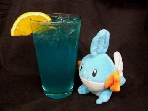 thedrunkenmoogle:  Mudkip (Pokemon Cocktail) Ingredients:1 oz. Fresh squeezed orange juice1.5 oz. blue curacao 2 oz white wine. (the fruitier the better)Fill with citrus soda Directions: For this cocktail, inspired by the sangria, shake the first three ingredients and pour into a glass.  Top the drink with your favorite citrus soda and place an orange slice on the rim of the glass as a garnish.  (Drink created and photographed by Mel the Office Gamer Girl)