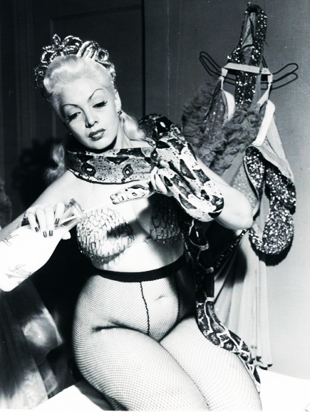 vintagegal:  Burlesque dancer, Zorita feeds her snake 1952