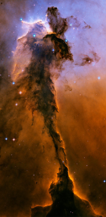 The dust sculptures of the Eagle Nebula are evaporating. As powerful starlight whittles away these cool cosmic mountains, the statuesque pillars that remain might be imagined as mythical beasts. Pictured above is one of several striking dust pillars of the Eagle Nebula that might be described as a gigantic alien fairy. (More) [Credit toThe Hubble Heritage Team, (STScI/AURA), ESA, NASA]