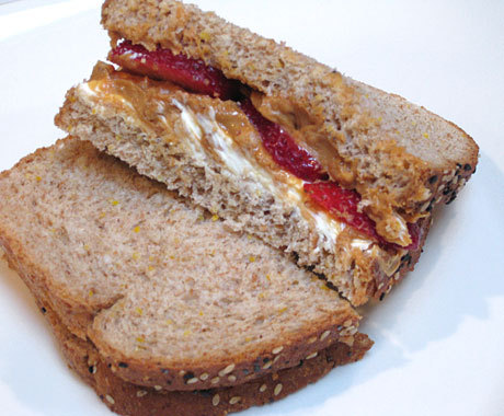 Peanut Butter Berry sandwich Ingredients 2 sliced of 100% whole wheat bread 1 tablespoon natural or no salt added peanut butter 1 tablespoon softened fat-free cream cheese 2 medium strawberries, hulled and sliced 1 teaspoon of honey Directions spread the peanut butter on one slice of bread, cream cheese on the other. Drizzle with honey and topped with slices of strawberry on either side. Cut in sandwich in quarters or halves. Nutrition Information: 417 calories, 13g of fat, 808mg sodium, 5.5g fiber, 26g protein.  The sandwich is designed to keep you full for long periods of time. most of the fat comes from the peanut butter but this has a lot of monounsaturated fat, which can lower LDL (bad) Cholesterol, even raise HDL (good) Cholesterol. Instead of Jelly the recipe calls for sliced strawberries to cut sugar but it's mixed with cream cheese to keep a sweet and creamy flavor. You can use any other type of berry on hand, but some fruits don't taste well with the peanut butter cream cheese mixture. For lower fat and calories use light bread with less than 100 calories (Nature's Own Double Fiber Wheat has 50 calories and 5g of fibera slice), and use better'n Peanut Butter with 50 calories per tablespoon or try no peanut butter at all. Plus the sandwich is kid friendly too, perfect sandwich for the first day of school.