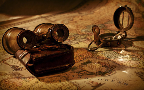Antique binoculars and compass