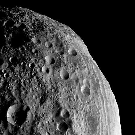 Dark shadows help define craters on the face of the large asteroid Vesta, named for the Roman virgin goddess of hearth and home, in a picture released August 22. NASA's Dawn spacecraft snapped the shot from the satellite's orbit around Vesta. The space rock is part of our solar system's main asteroid belt, between the orbits of Mars and Jupiter. The massive asteroid is considered a protoplanet, a would-be planet whose growth was interrupted in infancy by the formation of Jupiter.