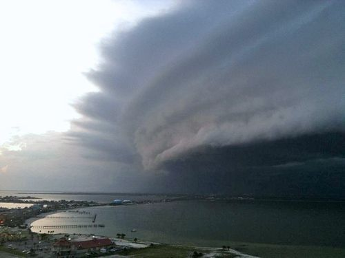 NOT Hurricane Irene, NOT North Carolina  This photo has gone viral on the internet, claiming to show Hurricane Irene hitting the coast of North Carolina yesterday. It is a real photo, but it is in fact a photo taken of a storm in Pensacola, FL on August 9th. Spread the truth! See more HERE and HERE.