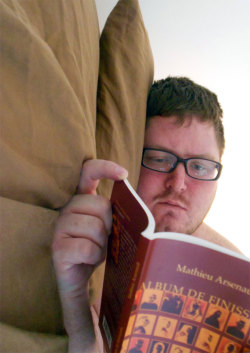 unfuckwithable:  #nakedreading Someone else did two, so I figured I could would, so deal with it.  Bonus points if you recognize the book.  Major bonus points if you've read it (and understood it). My bed is super comfortable, by the way.