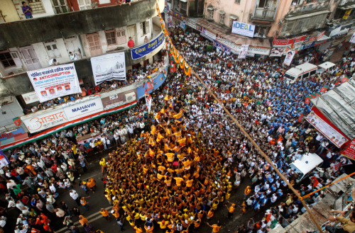 "Indian youth make a human pyramid to break the ""Dahi Handi."" (Rafiq Maqbool/Associated Press) (via Krishna Janmashtami - The Big Picture - Boston.com)"