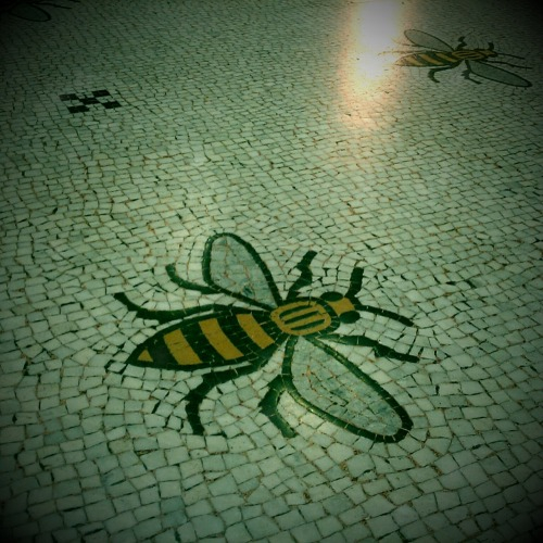"The Manchester bee ""The Manchester bee symbol was adopted during the Industrial Revolution,  a revolution that Manchester was at the heart of. The bee denotes  Mancunians hard work and graft during this era and Manchester being a  hive of activity in the 19th century. Bees are known as hard workers with a vital role to play in the ecosystem and the ability for humans and life forms to survive by pollinating crops. The allegorical link to bees relates that during this era, Manchester  was a vital economic centre for Britain and many Mancunians were  employed in a range of jobs in the city. Although it is unverifiable, the idiom busy bee may have originated or at least been popularised as a result of Manchester's adoption of the bee symbol."""