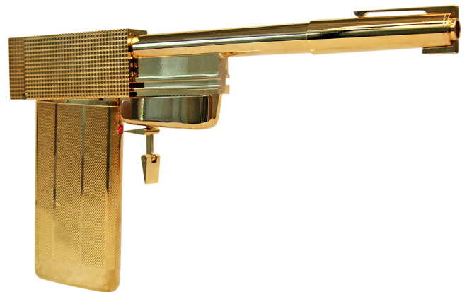 The golden gun! saw the original prop yesterday at the james bond 50 year exhibition in London, UK. Never realised that the gun was made of so many different components, some of which are a cigarette lighter for the handle, a pen for the barrel and a cufflink for the trigger!  There are also many other guns from the older james bond movies that took a lot of improv to create, such a guns made from film old film cameras. It was excellent!