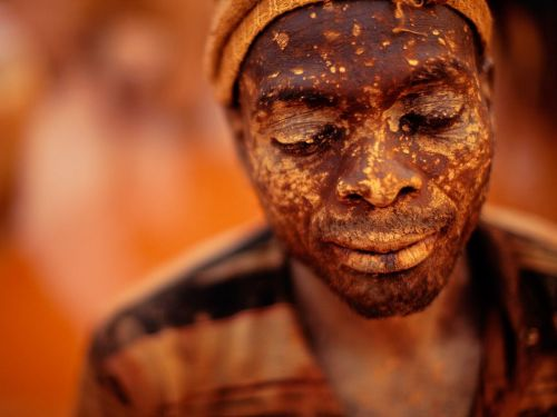 Gold Miner, Mozambique The glowing hues of dusk bathe a mud-splattered gold miner in the border province of Manica. The area draws scores of workers from neighboring Zimbabwe who pan for traces of the precious metal in turbid waters.