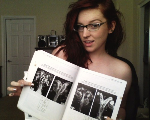 spiritguide:  Instead of nude reading, I'm nude flipping-through-my-new-textbooks. This one is called Pathways to Pregnancy and Parturition (these science nerds got a handle on alliteration, guys). And by the way, those are radiographs of excised female reproductive tracts. Sexy, right?