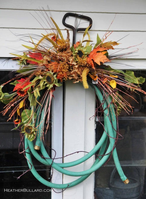 Oh, I love this. Recycled garden hose becomes Autumn Wreath.  ….with some velvet pumpkins thrown in for good measure. For contrast.
