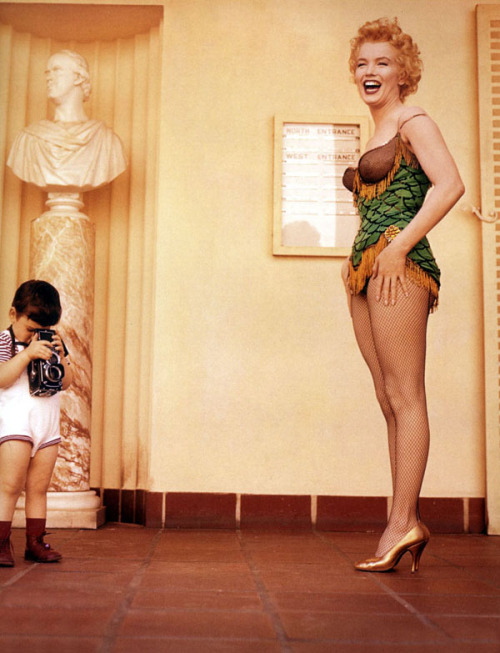 theniftyfifties:  Marilyn meets a young fan.