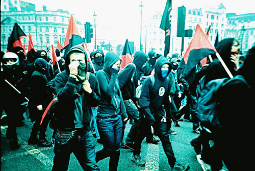 r-i-o-t:  Black Bloc passing through Trafalgar by Nic 0