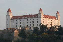 Bratislava Castle Monumental castle known from the beginning of 10th century, built on former Slavonian fortification from 9th century from Great Moravian Empireabove Danube river. Latest reconstruction is from 1956-1968. One of the city signatures. Location: N 48.142276, E 17.100043 Architecture styles seen in castle: romanesque, gothic, renaissance, baroque The castle stands on a hill where the earliest occupation dates back to the Neolithic period (5th millennium BC). The Castle was first time mentioned in Salzburg annals in 907 AD. Current appearance was built in 15th century AD (1427). The palace wing was built between 1431-34. Next reconstruction happened between 1552 - 1639 lead by Italian architects. The castle became coronation headquarters during the Tartar incursions from the east. The last big reconstruction was based on works of french, italian and austrian architects - J. N. Jadot, L. N. Pacassi and J. B. Martinelli in 1750-1760. In 1811 the castle was ruined by big fire and for 140 years remained damaged. The reconstruction started in 1953 restored its original appearance.