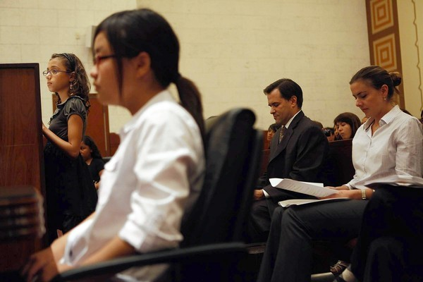 latimes:  A mock trial focusing on cyberbullying is the culmination of a 10-week series on the legal system for Los Angeles middle school students. It was sponsored by a downtown law firm and the nonprofit Heart of Los Angeles. Photo: Prosecutor Olimpia Aguillon, 11, left, and defense attorney Michelle Kweon, 12, with Bingham and McCutcheon's Mike McDonough and Kate Conrad. Credit: Katie Falkenberg / For The Times  I genuinely miss Mock Trial and how relevant the issues brought up in the cases were to the current day and age.