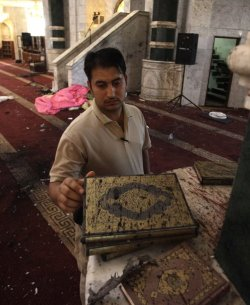 بعد تفجير أم القرى #Iraq A man inspects copies of the Quran, Muslims holy book, covered with blood, at Um al-Qura mosque in Baghdad, Iraq, Monday, Aug. 29, 2011. A suicide bomber blew himself up inside Baghdad's largest Sunni mosque Sunday night, killing dozens during prayers, a shocking strike on a place of worship similar to the one that brought Iraq to the brink of civil war five years ago. (AP Photo / Khalid Mohammed)