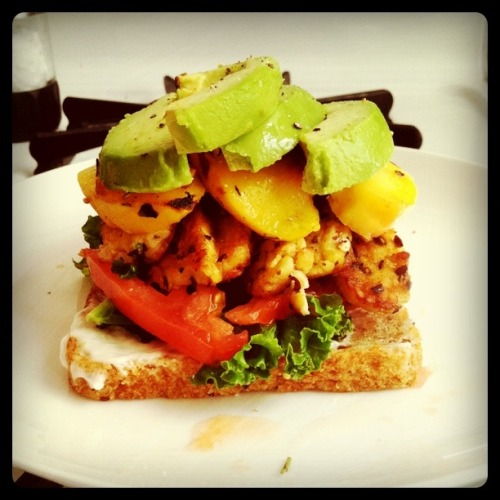 Summer sandwich:  Peaches and tempeh sauteed in olive oil with rosemary, thyme, cumin, paprika and red pepper; tomato; kale; avocado; vegenaise.  Top with salt and pepper and a second piece of toast.  So good.