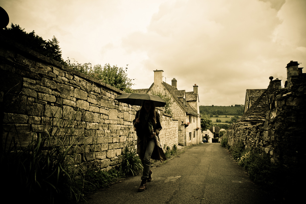 Wanderer on Flickr. Visiting towns in the Cotswolds it is not hard to imagine that Tolkien and other writers found inspiration here. Took this photo in Painswick just as it started raining and the umbrallas came out.