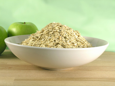 "yogi-health:  Top 10 reasons to eat oatmeal: Over 40 studies show that eating oatmeal may help lower cholesterol and reduce the risk of heart disease. According to Quaker, all it takes is 3/4 cup of oatmeal each day to help lower cholesterol. The soluble fiber in oats helps remove LDL or ""bad"" cholesterol, while maintaining the good cholesterol that your body needs. In January 1997, the Food and Drug Administration announced that oatmeal could carry a label claiming it may reduce the risk of heart disease when combined with a low-fat diet. The soluble fiber in oatmeal absorbs a considerable amount of water which significantly slows down your digestive process. This result is that you'll feel full longer, i.e. oatmeal can help you control your weight. You probably already have oats in your kitchen. It's estimated that eighty percent of U.S. households currently have oats in their cupboards. New research suggests that eating oatmeal may reduce the risk for type 2 diabetes. In fact, the American Diabetes Association already recommends that people with diabetes eat grains like oats. The soluble fiber in these foods help to control blood glucose levels. With the exception of certain flavored varieties, the oats found in your grocery store are 100% natural. If you look at the ingredients on a canister of rolled oats, you will usually see only one ingredient… rolled oats. According to recent studies, a diet that includes oatmeal may help reduce high blood pressure. The reduction is linked to the increase in soluble fiber provided by oatmeal. Oats contain more soluble fiber than whole wheat, rice or corn. Oatmeal contains a wide array of vitamins, minerals and antioxidants and is a good source of protein, complex carbohydrates and iron. The fiber and other nutrients found in oatmeal may actually reduce the risk for certain cancers. Oatmeal is quick and convenient. Every type of oatmeal can be prepared in a microwave oven. Even when cooked on the stovetop, both old-fashioned and quick oats can usually be made in less than 10 minutes. And what about instant oatmeal… a hot breakfast in under a minute… incredible! Oatmeal can be absolutely delicious! Whether instant, cooked on the stove or baked in the oven, the combination of flavors you can fit into a serving of oatmeal is limited only by the imagination. Visit Mr Breakfast's Oatmeal Collection to see just 60 of the ways you can start to enjoy oatmeal today!"