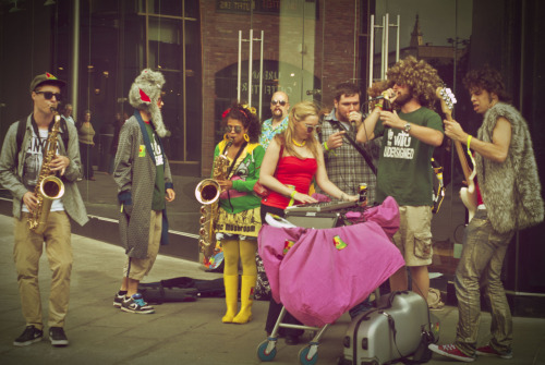 chrissimpsonstyle:  Funky Buskers from outer space  Please tell me this is a real band. Girl with the sax is killin' me.