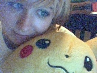 Me and my Pikachu! I've had him since I was 6. :3 My hair is pulled up. It's really not that short. P.S. My webcam is balls.