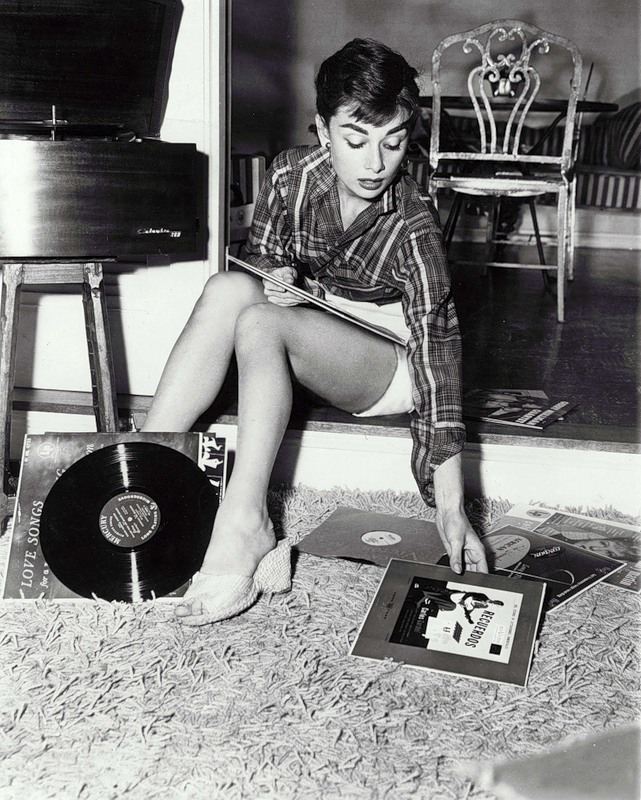 theniftyfifties:  Audrey Hepburn listens to records.
