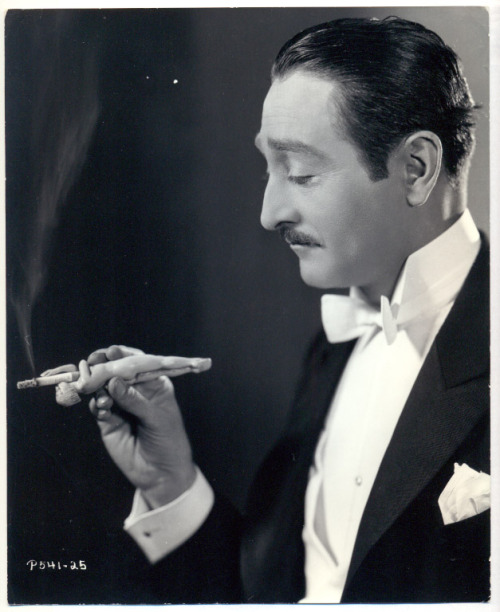 Adolph Menjou and his lady cigarette holder