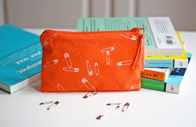 scissorsandthread:  Make Your Own Fabric Using The Sun | How About Orange This is one of the coolest things I've seen in a long time! This purse was made with a product called Inkodye. You paint your fabric with it and then lay objects over the top and pop it in the sun. How About Orange used safety pins on hers and it looks amazing. I'm trying to think of what else you could use to 'print' your fabric - maybe buttons? Or you could cut out shapes from card? So many possibilities!