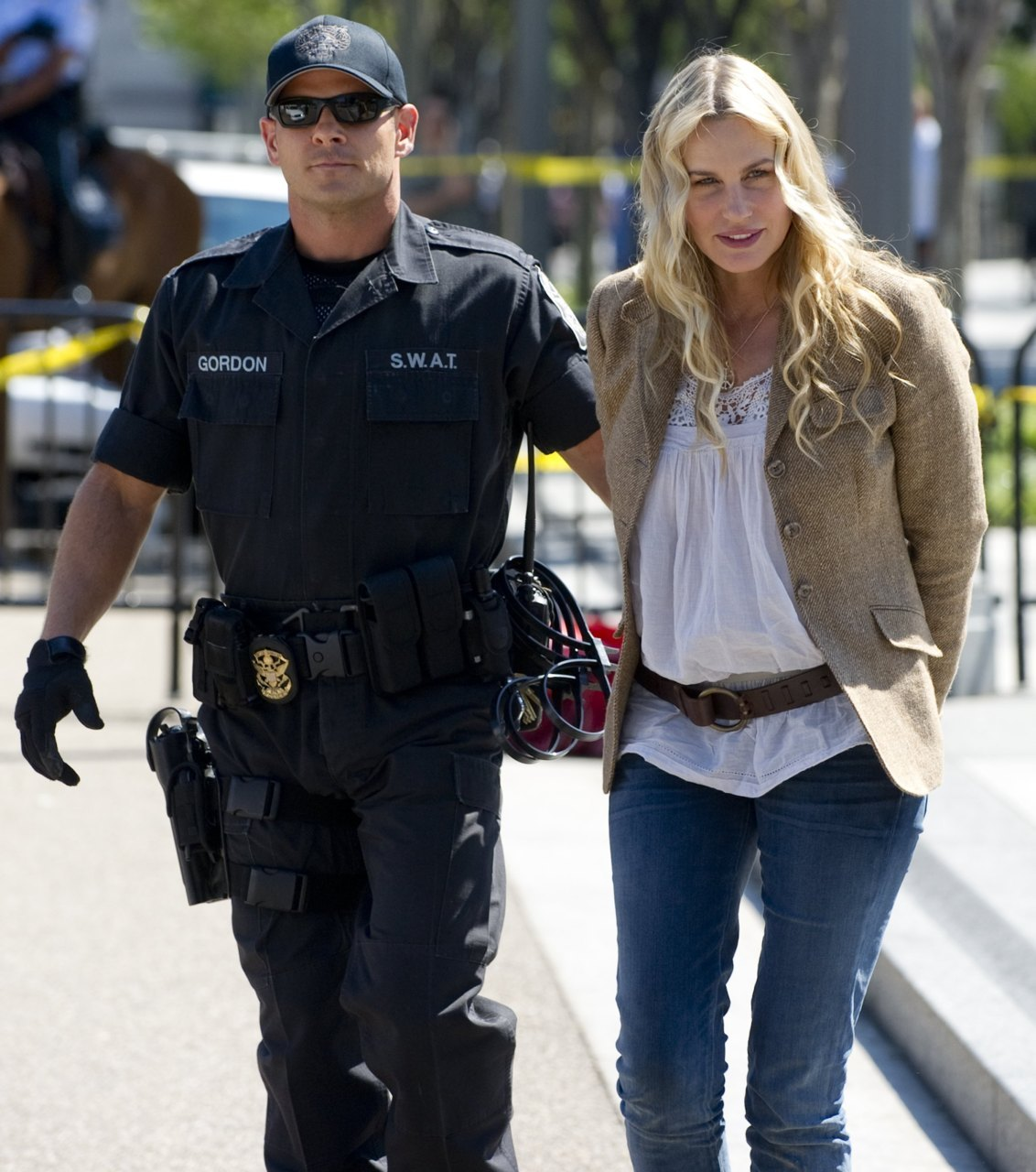 "Daryl Hannah arrested for protesting proposed Canadian oilsands pipelineActress Daryl Hannah, famous for her movie roles in Splash and Wall Street, was among dozens of anti-oilsands activists arrested Tuesday at the White House in ongoing ""sit in"" protests against TransCanada Corp.'s proposed Keystone XL pipeline.""Stop the Keystone pipeline,"" Hannah shouted as she was being handcuffed by SWAT team officers. ""No to the Keystone pipeline."" (Photo: Saul Loeb/AFP/Getty Images)"