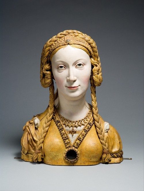 centuriespast:  Reliquary Bust of a Female Saint, ca. 1520–30 Oak, paint, gilt Overall: 16 11/16 x 12 3/4 x 6 1/4 in. (42.4 x 32.4 x 15.9 cm)The Cloisters CollectionThe Met  Oh dang, how awesome is her sassy face? I would totally put this on my bookshelf.
