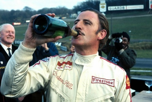 Graham Hill celebrating his pole at Brands Hatch, 1968.