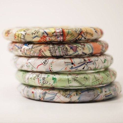 Recycled map bangles by Squishy Sushi.