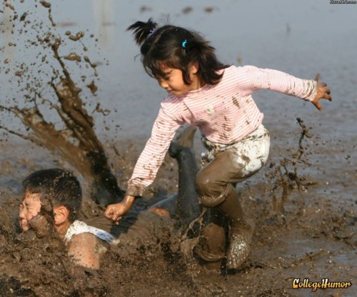 Little Girl Slams Brother into Mud Guess it's her choice of cartoons this Saturday morning.
