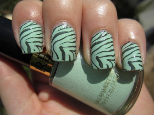 We love the mint green zebra print nails Beautylish Beauty Amanda L. is rocking! To get the look you can use the Konad M57 plate or try this nail tutorial and make your own stripes!