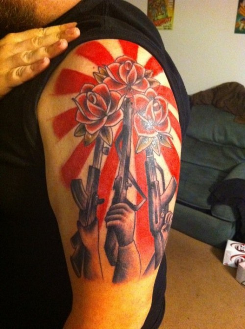 Guns and Roses Apparently today is Shepard Fairey day.  This tattoo is based on the street art I posted a few images up.