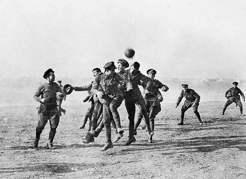 Soldiers during the First World War playing football on Christmas Day ,1914 .