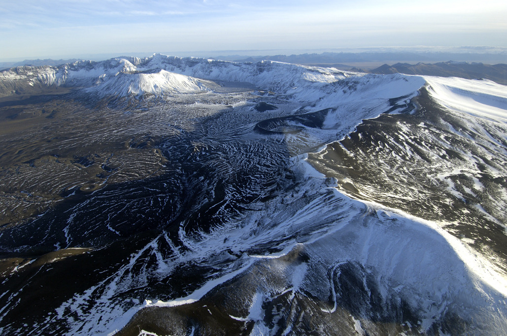 Aerial view of Aniakchak Caldera taken from northern rim. Credit: Roy Wood. (via Aniakchak National Monument & Preserve)